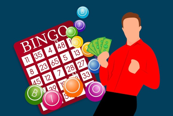 man holding money in front of bingo cards