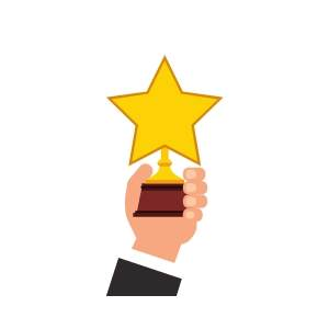 New Online Casinos - Hand Holding Up Star Trophy